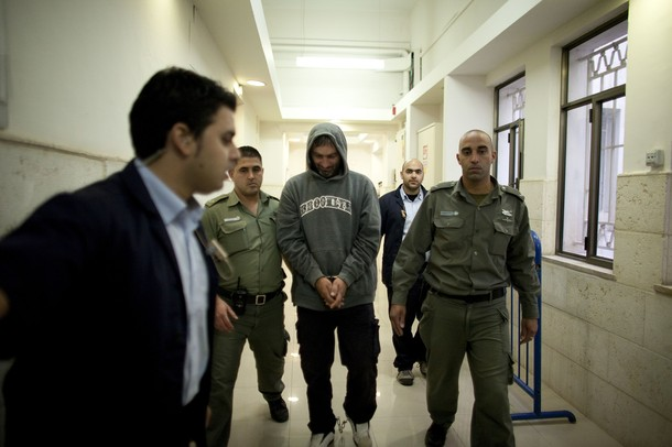 Aleksandar Cvetkovic (aka: Aleksander Cvetkovic), 42, (C) a former soldier in the Army of Republika Srpska, a Bosnian Serb Army, arrives for a remand hearing at the District Court on January 19, 2011 in Jerusalem, Israel. Cvetkovic is suspected of taking part in the Srebrenica genocide. He personally directed executions of up to 1,200 unarmed Bosnian Muslims (Bosniaks) at Branjevo farm, one of series Srebrenica massacre sites.
