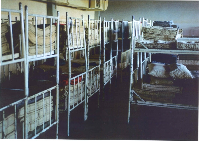 Beds in the Omarska concentration camp near Prijedor, north-west Bosnia. Beds were introduced as a media propaganda after the Serb leadership allowed British TV crews to visit Omarska. Prisoners slept on the floor. Thousands of Bosniak (Bosnian Muslims) civilians were interned, tortured, raped and killed in this camp.