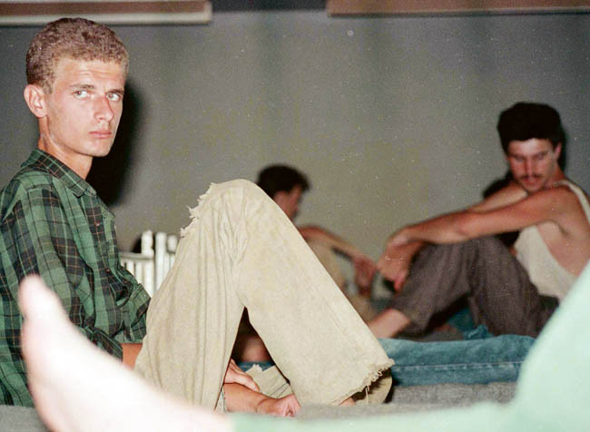 Bosnian Genocide (1992), Bosnian Muslim (Bosniak) prisoners in Omarska concentration camp.