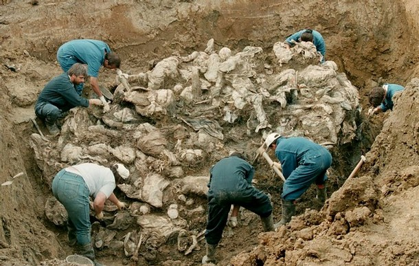Bosnian Genocide (1995), Forensic experts of the International war crimes tribunal inspect remains of the Srebrenica massacre victims in the Pilica mass grave on 24 July 1995.