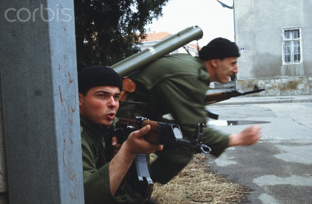 Bosnian Genocide, 1992: Serbian paramilitaries during the attack on Bijeljina in northeastern Bosnia in the first day of war on 31 March 1992. They slaughtered hundreds of unarmed Bosniak (Bosnian Muslim) civilians - men, women, children and elderly. Photographer: Ron Haviv