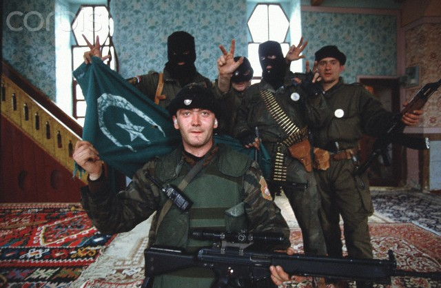 Bosnian Genocide, 1992: Serbian paramilitaries known as Arkan's Tigers desecrate Mosque in the northeastern Bosnian town of Bijeljina on 31 March 1993, the first day of the Bosnian war. Serbian troops slaughtered hundreds of Bosniak men, women, children and elderly during the attack on Bijeljina. Photographer: Ron Haviv