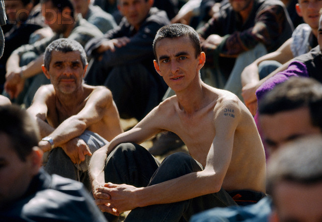 Bosnian Genocide, August 1992. Manjaca concentration camp near Prijedor, north-west Bosnia. Thousands of civilians, mostly Bosniaks (Bosnian Muslims) were tortured and killed there. Photographer: Pascal Le Segretain