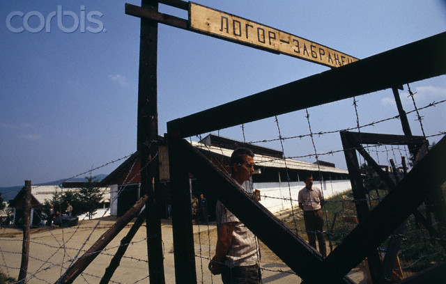 Bosnian Genocide, August 1992. The entrance to the Manjaca concentration camp reads in cyrillic letters CONCENTRATION CAMP - PROHIBITED ENTRY. Thousands of civilians, mostly Bosniaks (Bosnian Muslims) were tortured and killed there. Photographer: Antoine Gyori