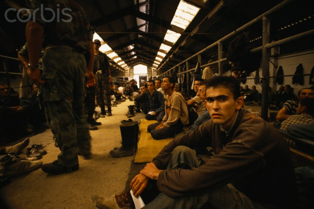 Bosnian Genocide, August 1992. Emaciated prisoners in the Manjaca concentration camp near Prijedor, north-west Bosnia. The camp was controlled by Lieutenant Colonel Bozidar Popovic.Thousands of civilians, mostly Bosniaks (Bosnian Muslims) were tortured and killed there. Photographer: Antoine Gyori