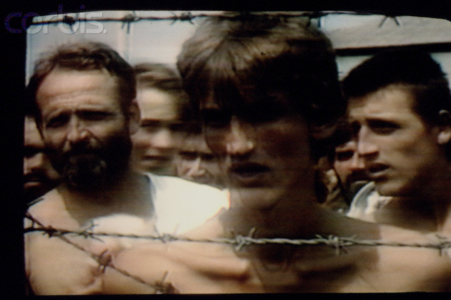 Bosnian Genocide, 1992:  TV pictures of the Serb-run Omarska concentration camp in western Bosnia near Prijedor, August 1992. Thousands of civilians, mostly Bosniaks (Bosnian Muslims), died there.