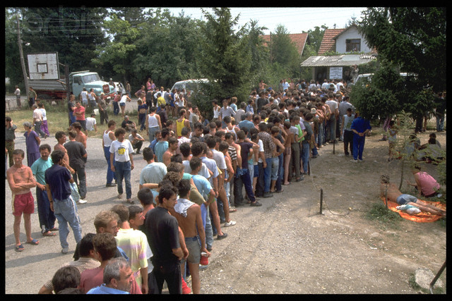 Bosnian Genocide, 1992: Emaciated non-Serb civilians during a staged lunch, posing for TV cameras, at the Serb-run Trnopolje concentration camp near Prijedor in 1992. Thousands of prisoners, mostly Bosniaks (Bosnian Muslims), were tortured and killed there in 1992. Photographer: Patrick Robert
