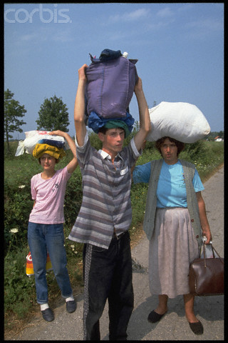 Bosnian Genocide, 1992: Bosniak (Bosnian Muslim) woman and children upon arrival to the Serb-run Trnopolje concentration camp in August 1992. Thousands of non-Serbs civilians were tortured, raped and killed there in 1992. Photographer: Patrick Robert