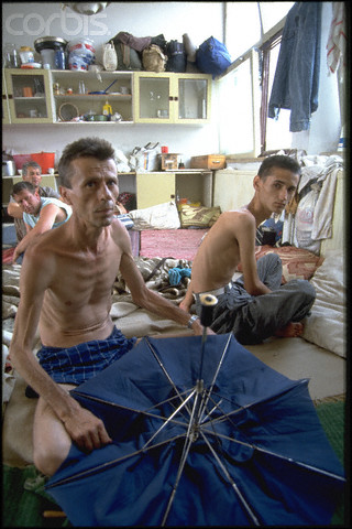 Bosnian Genocide, 1992: Emaciated non-Serb civilians imprisoned in the Serb-run Trnopolje concentration camp near Prijedor in 1992. Thousands of prisoners, mostly Bosniaks (Bosnian Muslims), were tortured and killed there in 1992. Photographer: Patrick Robert