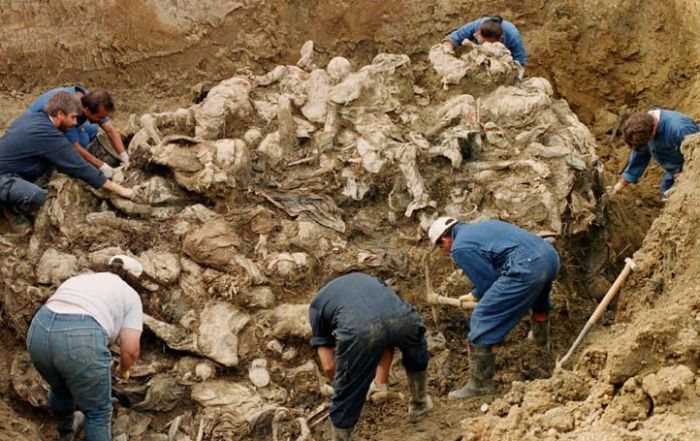 Bosnian genocide mass grave at Pilica farm near Srebrenica, twenty feet deep and a hundred feet long, was excavated by forensic pathologists in 1996. Bosniak victims were blindfolded with hands tied behind their back. Photo by Gilles Peress (from The Graves: Srebrenica and Vukovar (Scalo Books, 1998)).