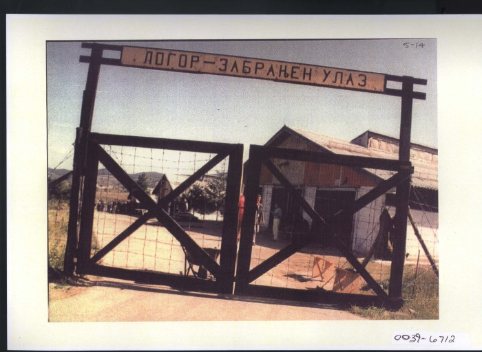 The Sign reads CONCENTRATION CAMP. PROHIBITED ENTRY. Photo: Entrance to the Manjaca concentration camp near Prijedor, north-west Bosnia, where Serbs interned, tortured, raped, and killed thousands of Bosniaks (Bosnian Muslims).