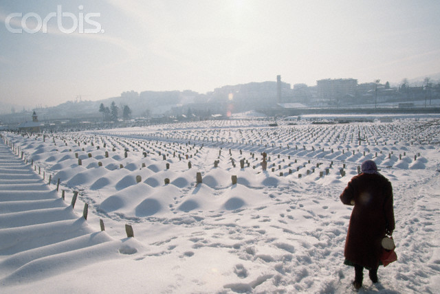 A woman stands near the area of Sarajevo that was used for the 1984 Winter Olympic Games which now holds the graves of thousands of casualties of the international armed conflict between Bosnia and Serbia.